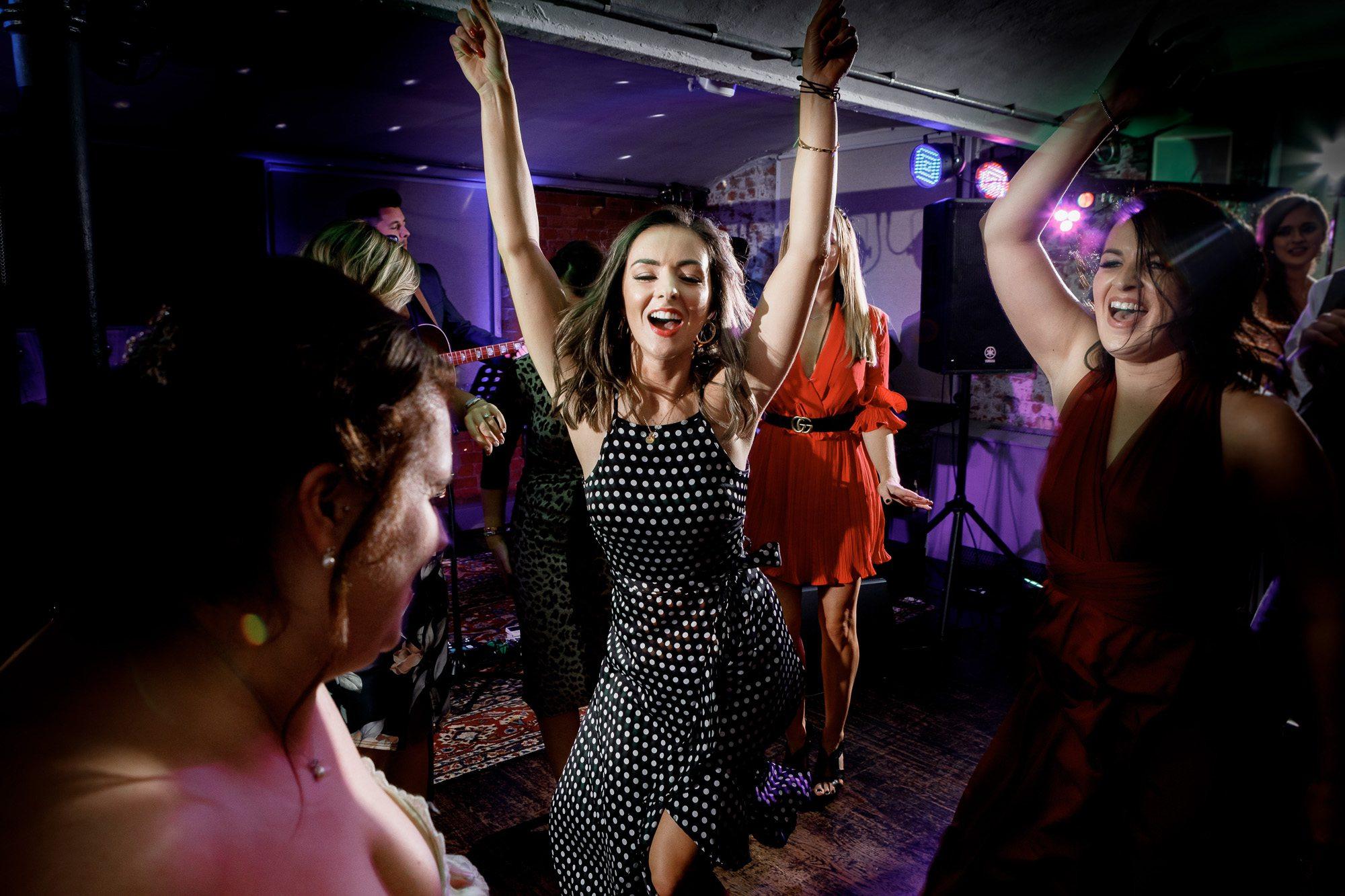 wedding guest dancing on dance floor